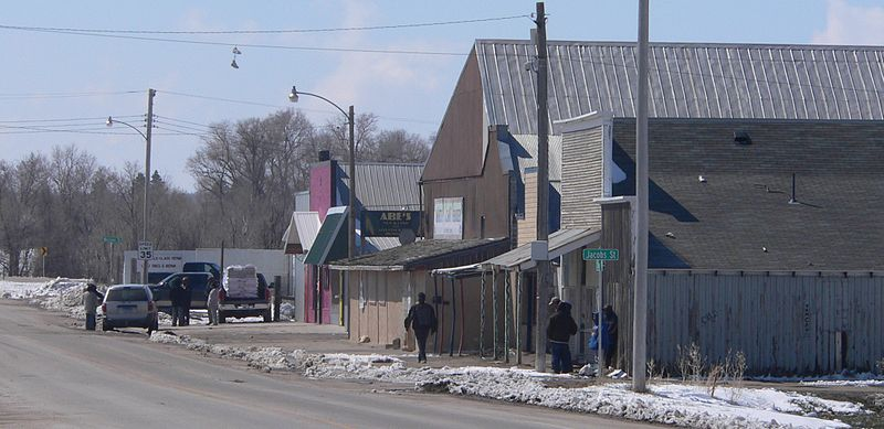 Whiteclay, Nebraska, sells more beer per capita than any town in America. In 2009, the four liquor stores in the town of around 14 people sold 4.6 million cans of beer. Do the math